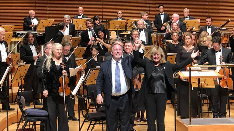 BMI composer Lucas Richman receives thundering applause on stage with the conductor of the Los Angeles Jewish Symphony, Noreen Green.