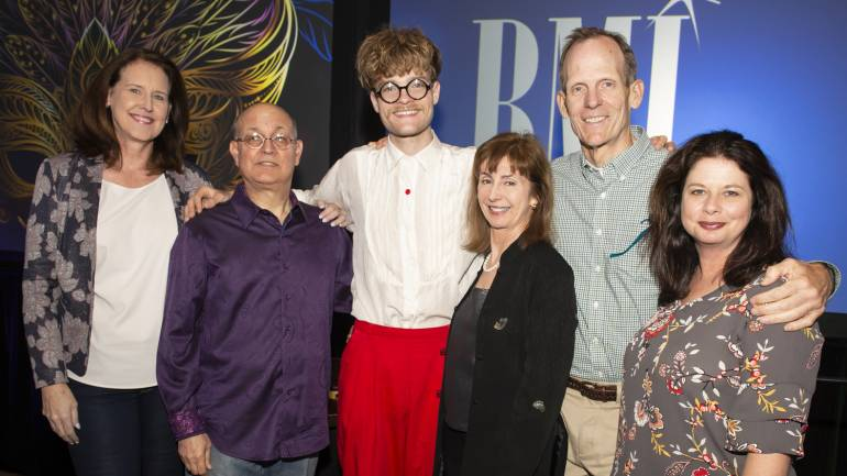 Pictured (L-R) before Jake Wesley Rogers' performance at the MFM Awards Reception at the Hilton Riverside Hotel in New Orleans are: WarnerMedia SVP/ Deputy Controller and MFM Board Chair Cindy Pekrul, Manship Media CFO and Media Finance Focus Conference Chair Ralph Bender, BMI songwriter Jake Wesley Rogers, MFM President and CEO Mary Collins, and BMI's Jessica Frost and Dan Spears.