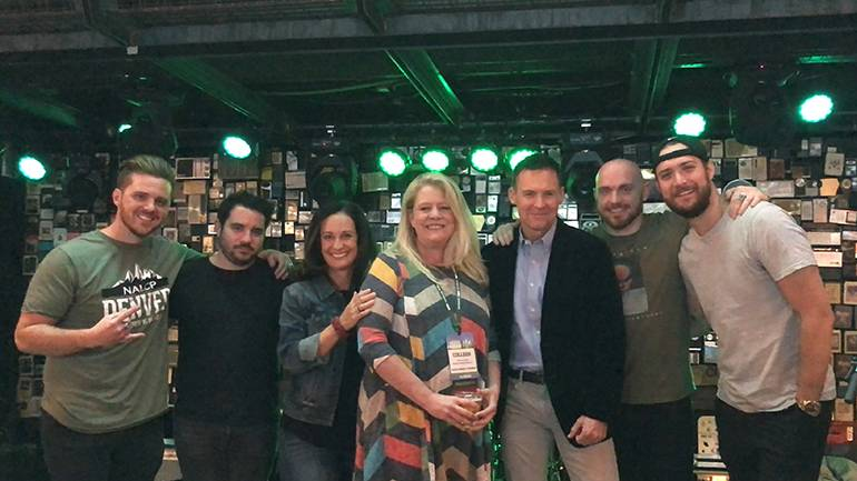 Pictured before BMI band Northern National takes the stage at the NALCP annual conference kickoff party at Ophelia's Electric Soapbox in Denver are: Northern National's Michael Kanne, and Michael Rossi, NALCP Executive Director Jill Valachovic, Darden Restaurant Director of Licensing and NALCP Board President Colleen Lyons, BMI's Brian Mullaney, and Northern National's Anthony Comas and Dylan Green.