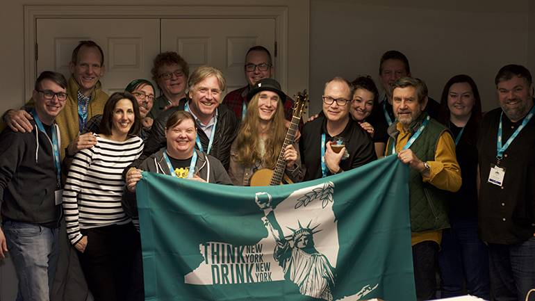 Prior to his concert, Sawyer Fredericks posed with staff and members of the board of the New York State Craft Brewers Association. Pictured (L-R) are: Roc Brewing co-founder and CEO Chris Spinelli, BMI's Dan Spears, NYSBA Head of Partnerships Meghan Connolly Haupt, Community Beer Works co-founder and President Ethan Cox, Hopshire Farm Brewery owner and brewer Randy Lacey, Binghamton Brewing founder and owner Kristen Lyons, FX Matt Brewery President and COO Fred Matt, Brewery at the CIA's Hutch Kugeman, BMI Songwriter Sawyer Fredericks, NYSBA Executive Director Paul Leone, NYSBA Membership & Events Manager Jen Meyers, Greenport Harbor Brewing co-founder and owner Rich Vandenburgh, Brooklyn Beer co-founder and owner Steve Hindy, Rushing Duck co-founder and owner Nikki Cavanaugh and Lake Placid Pub % Brewery/Big Slide Brewing owner Chris Ericson.