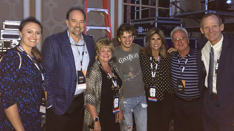 Pictured (L-R) after BMLG recording artist Payton Smith's performance at the 2019 Radio Show are: Butte Broadcasting's Maggie Davis, Guaranty Broadcasting President Flynn Foster, Louisiana Association of Broadcasters President/CEO Polly Johnson, BMI songwriter Payton Smith, North Dakota Broadcasters Association Executive Director Beth Helfrich, Missouri Association of Broadcasters Director of MO-PEP Frank Forgey and BMI's Dan Spears.