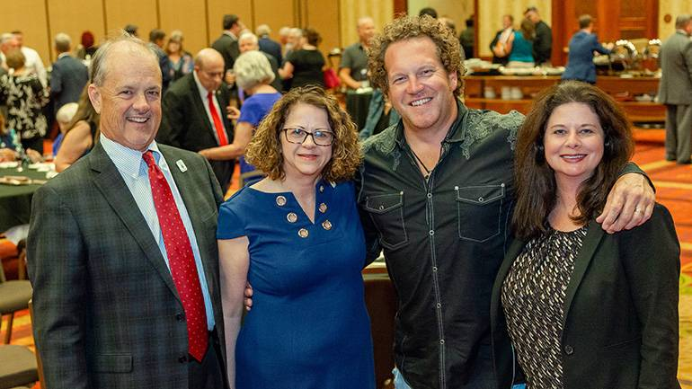 Pictured (L-R) before Denim took the stage are: TAB President Whit Adamson, TAB Board Chairman and General Manager WKRN Nashville Tracy Rogers, BMI songwriter Joe Denim and BMI's Jessica Frost.