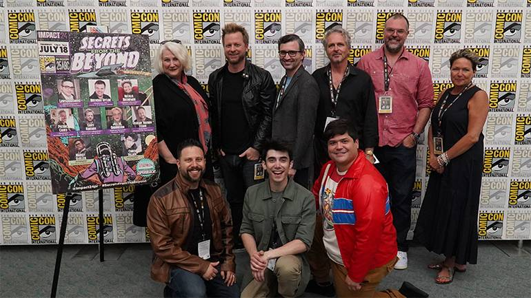 """The panel from """"Secrets from the Beyond"""" gather for a photo."""