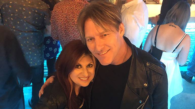 BMI composer Tyler Bates and BMI's Anne Cecere gather for a photo at the premiere of his Cirque Du Soleil show during the Fandom party.