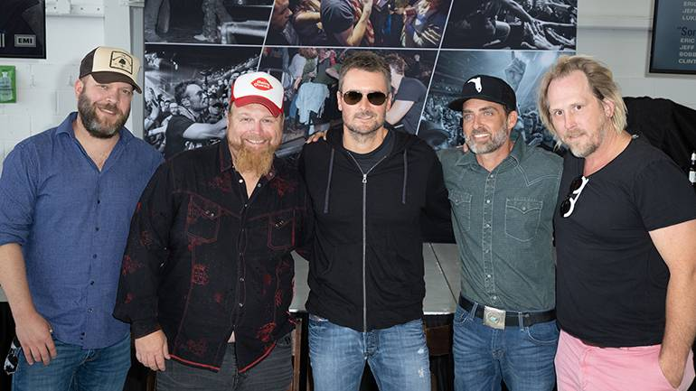 BMI songwriters Jeff Hyde, Bobby Pinson, Eric Church, Clint Daniels and Luke Dick pose for a photo at their Number One celebration.