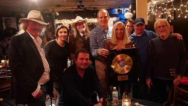 Pictured (L-R) after BMI's presentation of a Gold Record to Florida Restaurant & Lodging Association President Carol Dover are: (kneeling): BMI songwriter Dylan Altman. (standing): BMI songwriter Earl Bud Lee, BMI songwriter and Warner Brothers recording artist Charlie Worsham, BMI Hall of Fame songwriter Aaron Barker, BMI's Dan Spears, FLRA President Carol Dover, and BMI songwriters Bridgette Tatum, Tim James and Bruce Channel.