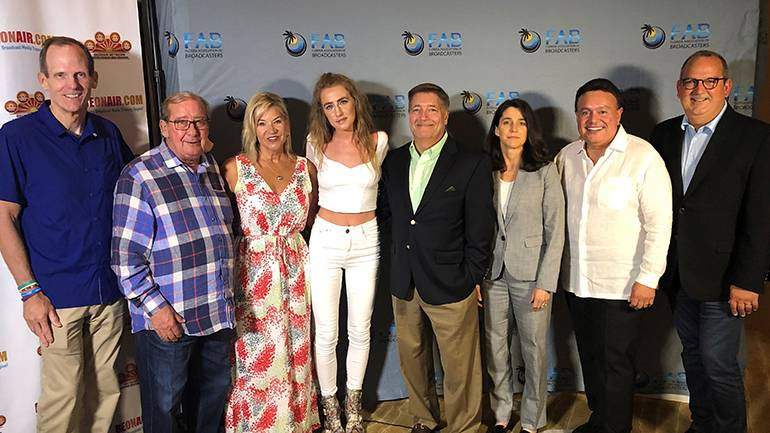 BMI songwriter Ingrid Andress poses for a photo with the FAB's executive committee prior to taking the stage at their annual convention at the Ritz Carlton in Fort Lauderdale. Pictured (L-R) are: BMI's Dan Spears, FAB President and CEO Pat Roberts, WCTV-TV Vice President and General Manager Heather Peeples, BMI songwriter Ingrid Andress, Sinclair Broadcast Group Market Manager for West Palm Beach and FAB Board Chair Mike Pumo, Montclair Communications President Lara Kunkler, Actualidad Radio President and CEO Adib Eden, and Univision Communications President and Regional Manager Luis Fernandez-Rocha.
