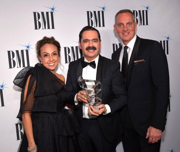 L to R: BMI's VP, Creative Latin Music Delia Orjuela, BMI Presidents' Award recipient Mario Quintero Lara, and BMI President & CEO Mike O'Neill together at the 26th annual BMI Latin Awards