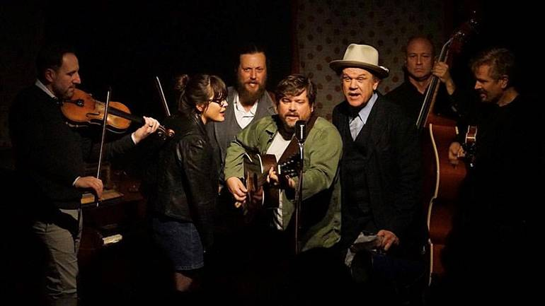 """Pictured (L-R) onstage are Gabe Witcher of Punch Brothers, Sara Watkins of Nickel Creek, Isreal Parker, Sean Watkins of Nickel Creek, BMI songwriter, musician and actor John C Reilly, and BMI composers, creators, directors and producers of """"Call Me Mr. Bluegrass,"""" Mike Judge and John Frizzell."""