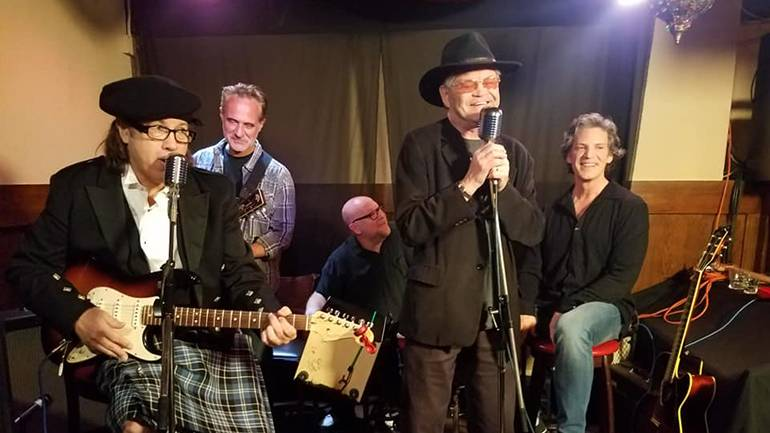 Pictured on stage are New Monkees Marty Ross, Jared Chandler and Dino Kovas, original Monkee Micky Dolenz, and New Monkee Larry Saltis.