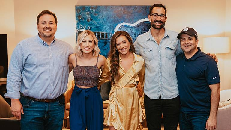BMI's Mason Hunter, Maddie & Tae, BMI's Branden Bosler and Big Machine Music's Mike Molinar gather for a photo backstage.