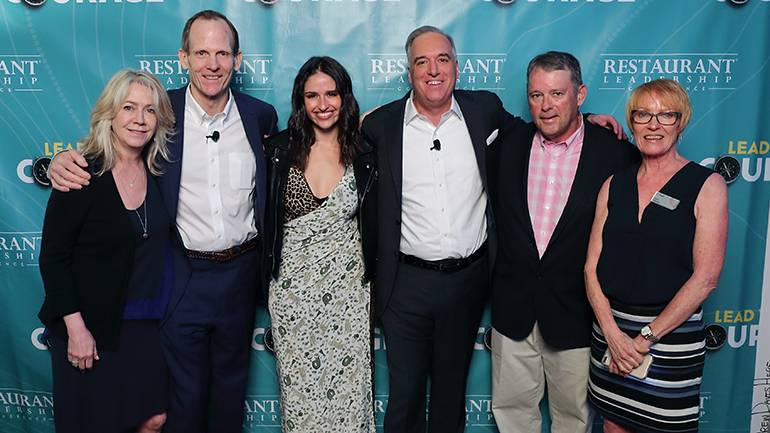 Pictured (L-R) before Rozzi's performance at the 2019 Restaurant Leadership Conference in Phoenix are: Colorado Restaurant Association Vice President of Strategic Partnerships Devany McNeill, BMI's Dan Spears, BMI singer-songwriter Rozzi, Winsight Group President of Restaurant & Media Events Chris Keating, Barley Creek Hospitality Group President Trip Ruvane and Winsight Senior Vice President and Restaurant Leadership Conference Director Carol Walden.