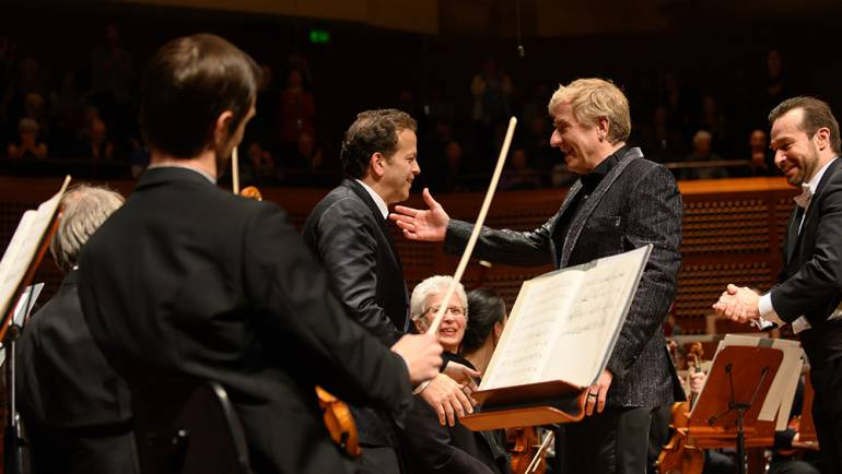 "Pianist Jean-Yves Thibaudet congratulates BMI composer Aaron Zigman on his new concerto for piano and orchestra, ""Tango Manos,"" which made its U.S. premiere with the San Francisco Symphony."