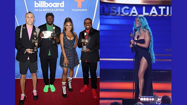 Pictured are Billboard Latin Music Award winners Black Eyed Peas and Karol G