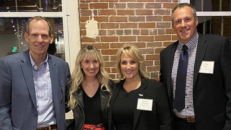 Pictured (L-R) after Emily Shackelton's performance at the MBA annual conference in Stillwater are: BMI's Dan Spears, BMI songwriter Emily Shackelton, MBA President & CEO Wendy Paulson, and KROX-AM President/GM & MAB Board Chair Chris Fee.