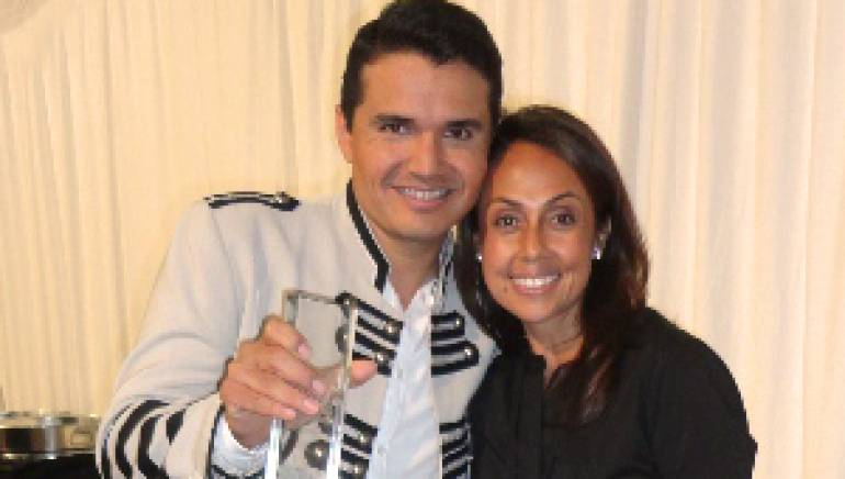 Pictured:  BMI's Delia Orjuela congratulates Horacio Palencia on his Songwriter of the Year Award at the Billboard Mexican Music Awards