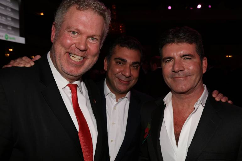Pictured left to right: Octopus TV's Andrew Eborn, BMI's Brandon Bakshi and SYCO Entertainment's Simon Cowell, the 2015 MITS Award honoree.